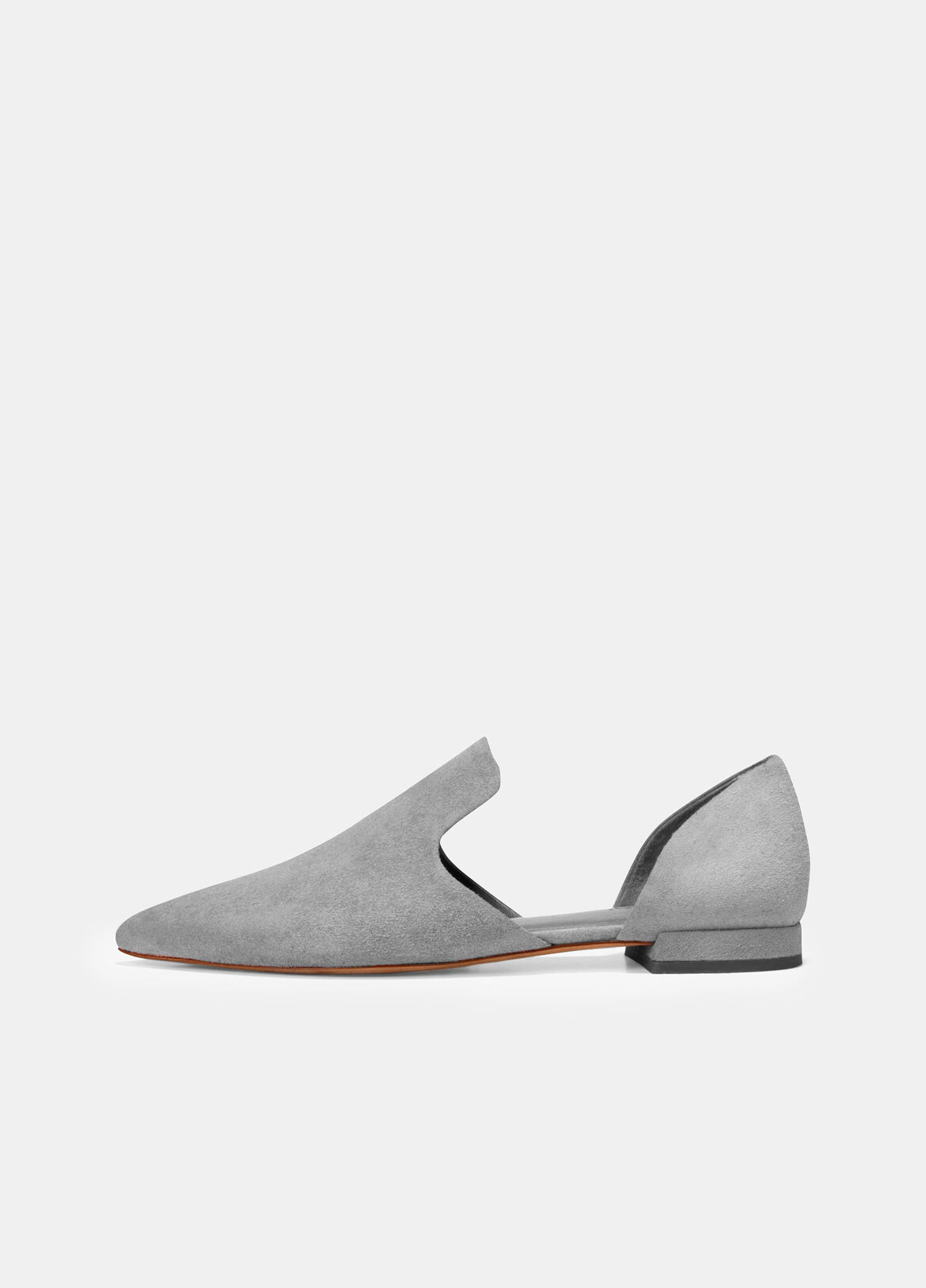 Italian-crafted in luxe suede, these flats have a modern d'Orsay silhouette. The streamlined design is accentuated by an extended vamp and the soft curvature of cut-out side panels.