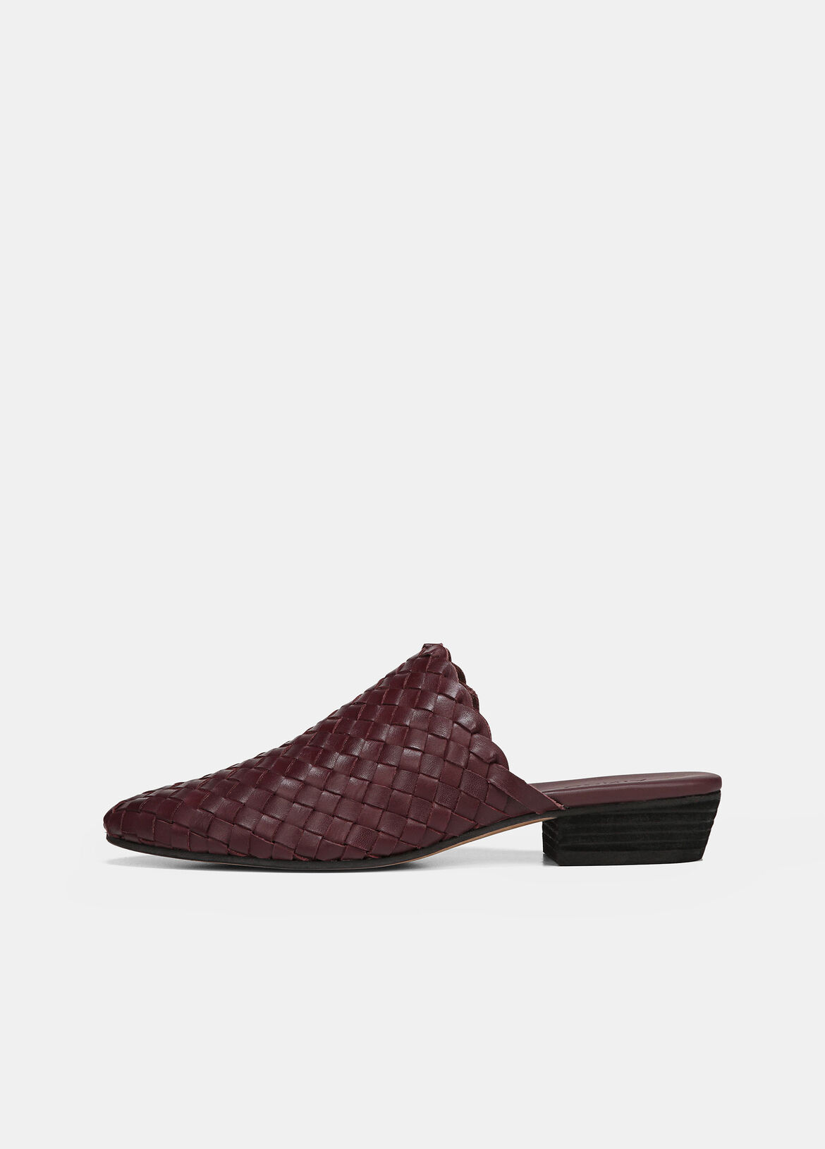 The Galena mules are made from woven strips of soft leather. Set on stacked heels, they have a round almond silhouette that's ideal for culottes or dresses.