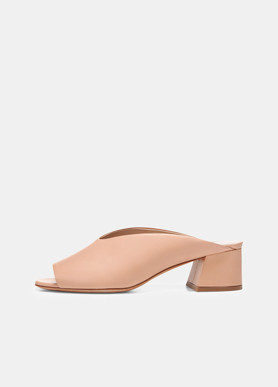 The Cachet slides have a sleek, modern silhouette in smooth leather. They're set on slanted block heels and are finished with a round open toe.