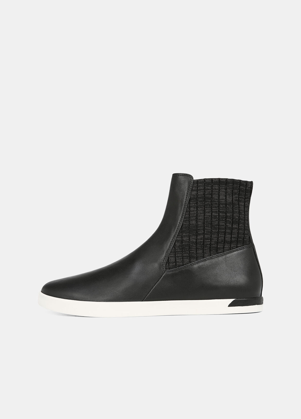 Set on rubber roles, the Vidra Sneaker features an ankle-high silhouette with slip-on ease. A mixed media construction reveals tonal, multi-textural panels of leather and knit.