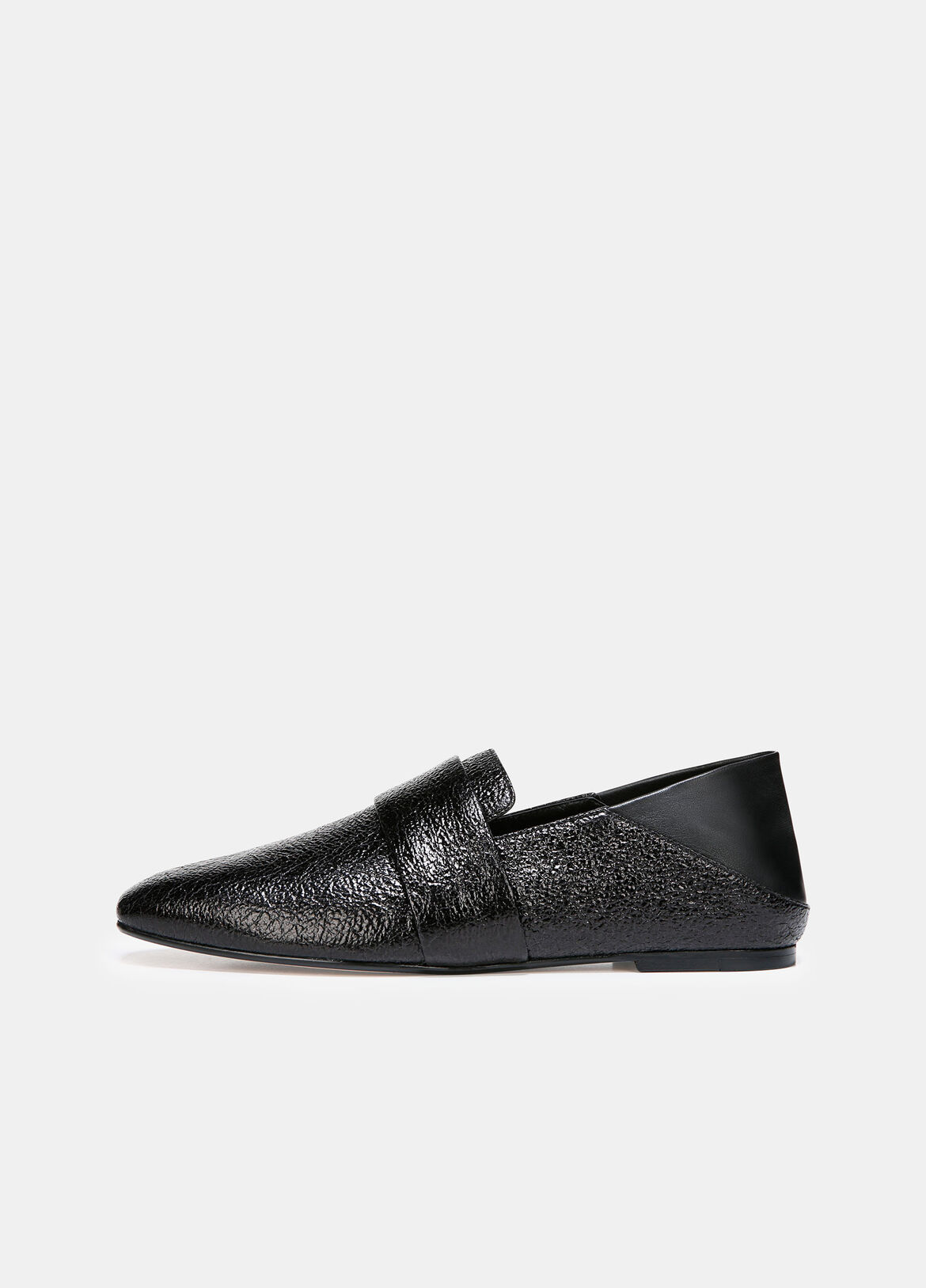The pared-back loafer feels luxurious in crinkle-textured leather. Details reveal a minimal penny keeper and a fold-down heel-go from sleek to casual with an effortless collapse.