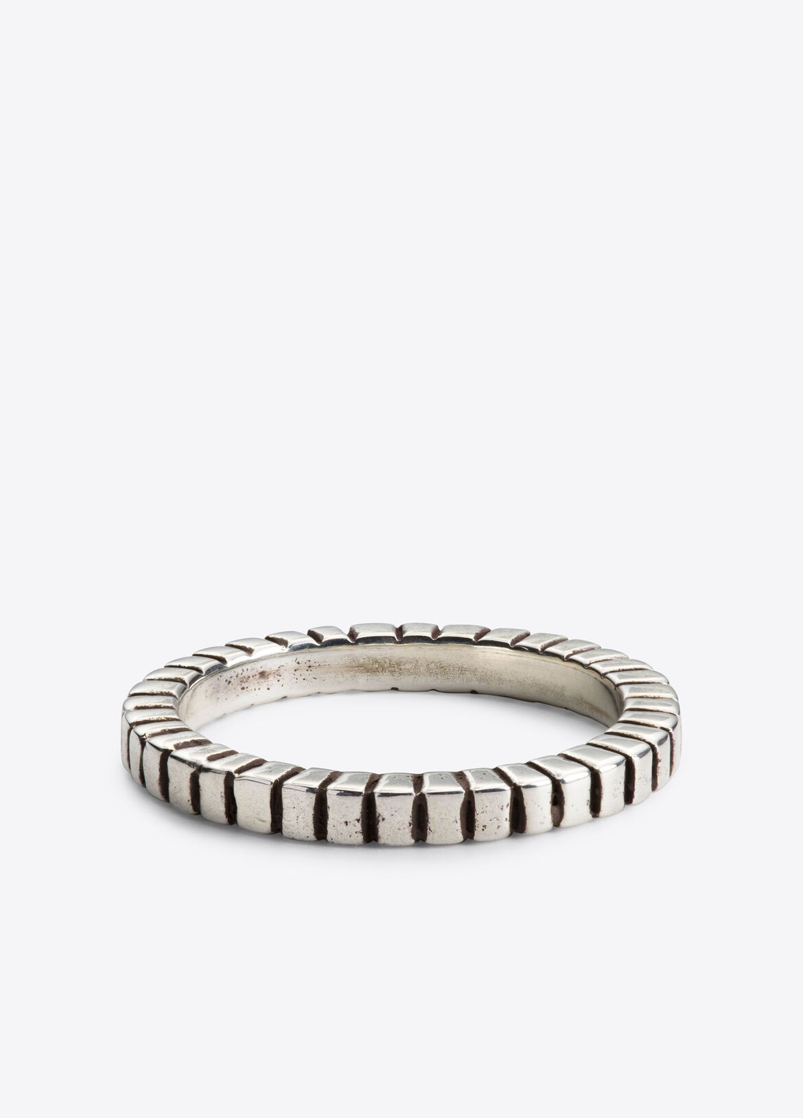 Inspired by her young life spent in both Iran and Paris, Catherine M. Zadeh's namesake New York City-based contemporary jewelry line is a highly considered collection founded on understatement and simplicity. Each sculptural shape seeks to inspire thought, while adding refinement and elegance to the wearer's aesthetic. Ribbed sterling silver ring finished with some oxidation for soft contrast.
